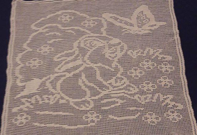 Crochet filet baby blanket with Thumper work photo by Facebook User Mario Gatti