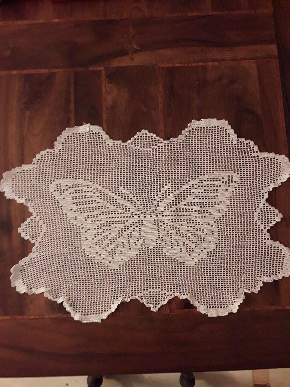 Crochet filet doily with butterfly work photo by Facebook Fan Mario Gatti